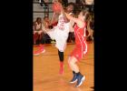 Jazmine Anderson (12) gets fouled as she drives to the hoop versus Lewisburg.